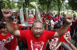 Anti-government protester from the Red Sunday group gestures during a rally at a park in Bangkok