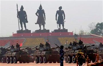 Armored-personnel-carriers-participate-in-a-parade-during-the-68th-anniversary-celebrations-of-Armed-Forces-Day-in-Naypyidaw-Myanmar-Wednesday-March-27-2013.