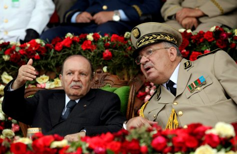 FILE PHOTO: Algeria's President  Abdelaziz Bouteflika gestures during a graduation ceremony of the 40th class of the trainee army officers at a Military Academy in Cherchell